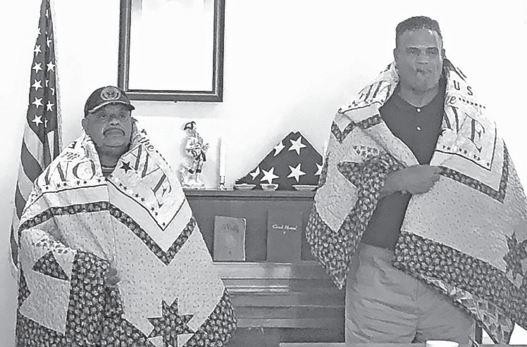 Juan Garcia (left) and Lewis Byers receive Quilts of Valor during a June 25 ceremony at Oneonta Senior Center.