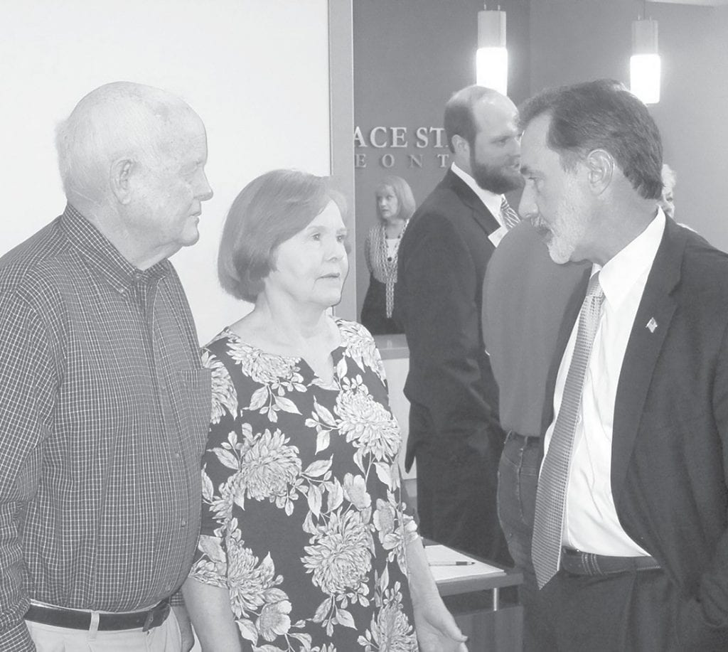 Rep. Gary Palmer (right) chats with Jack and Pat Standridge during his meet and greet event at Wallace State.