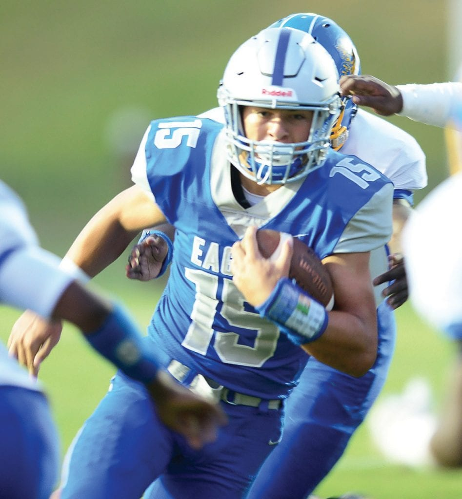 Chase Payne (15) racked up 103 yards on 19 carries and three touchdowns. -www.southernexposurephotos.com