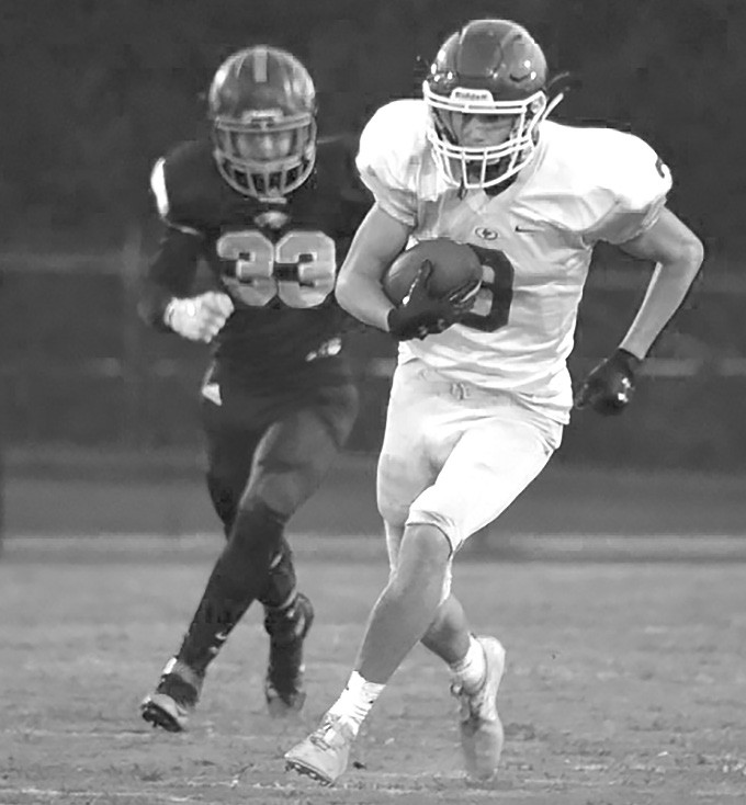 Braden Ellison (3) is pursued by an East Lawrence defender. -Locust Fork High School Football | Facebook