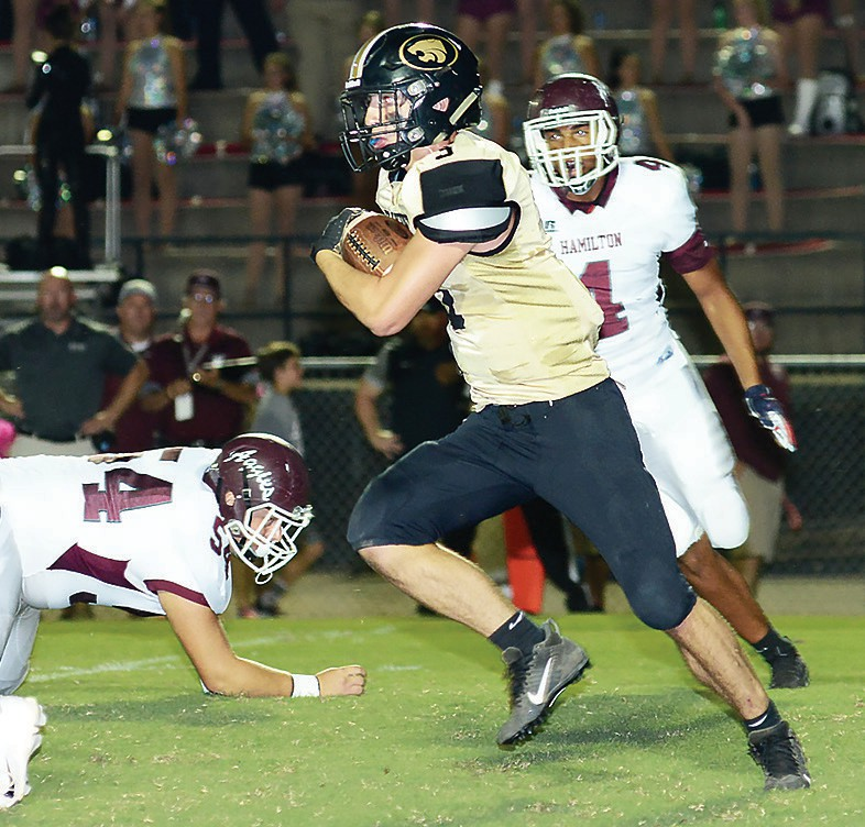 Hayden's Carson Rickels (3) looks for an opening in the Hamilton defense. -Blount Photographic