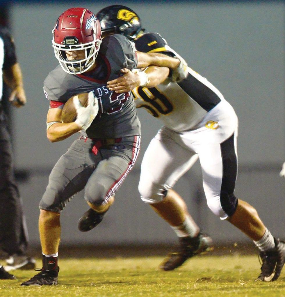 Andrew McAlpine (13) shucks a Cherokee County defender. -www.southernexposurephotos.com