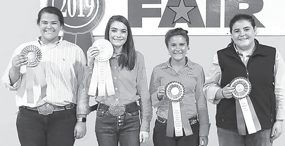 Winners in the Senior Division of the Premier Exhibitor contest during the 2019 Youth Beef Cattle Show Oct. 6 in Montgomery. From left: Hannah Maddox, high individual (Dekalb Co.); Audra Graves, second (Blount Co.); Isabella Kent, third (Baldwin Co.); and Lakin Whatley, fourth (Montgomery Co.) Heather Gladney, fifth (Tuscaloosa Co.) is not pictured. The Premier Contest tests students' livestock knowledge, evaluation skills, and showmanship. The contest, held during the Alabama National Fair, was sponsored by the Alabama Farmers Federation and Alfa Insurance. -Alabama Farmers Federation