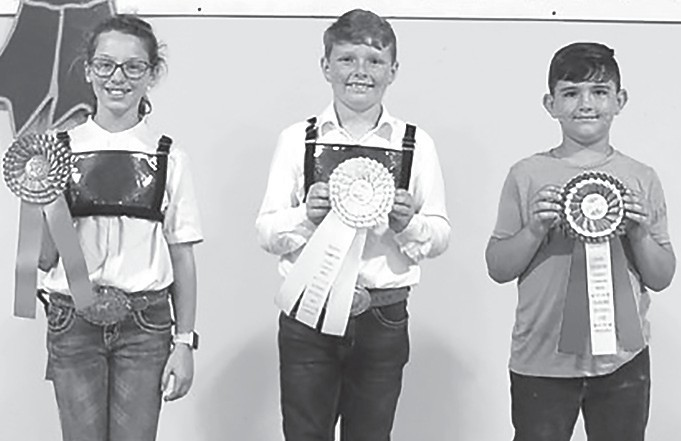 Winners in the Junior Division of the Premier Exhibitor contest during the 2019 Youth Beef Cattle Show Oct. 6 in Montgomery. From left: Sara Beth Faust, high individual (Blount Co.); Asa Thompson, second (Pike Co.); and Greer Jones, third (Pike Co.) -Alabama Farmers Federation