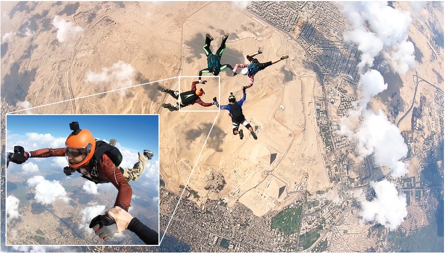 Daniel Warden (orange helmet) and crew skydive above Egyptian pyramids (visible in the lower middle portion of the photo.) -photos provided by Daniel Warden