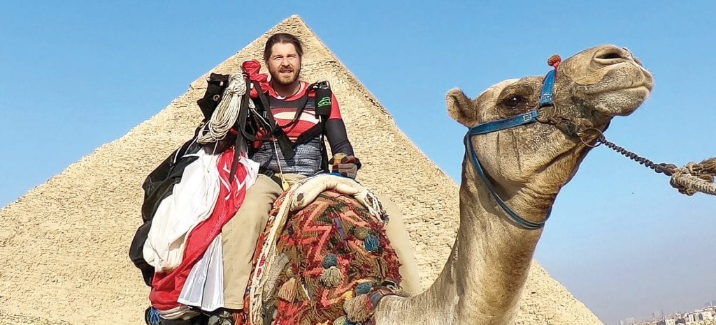 "Warden astride the camel he ""hailed"" after landing off course in the desert."