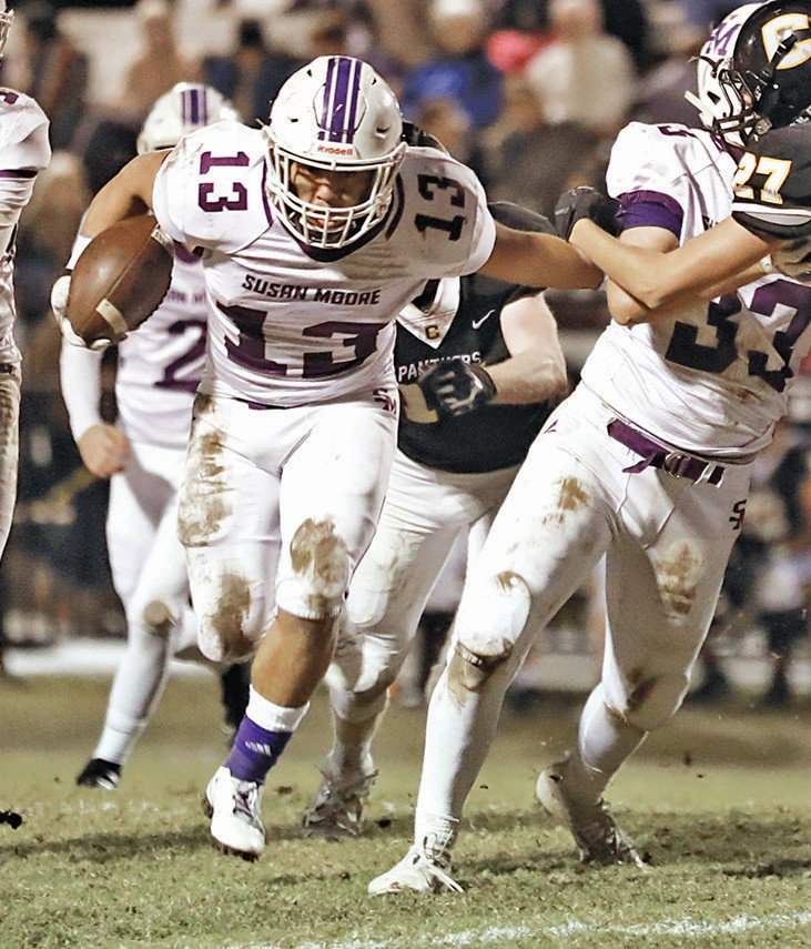 Anthony Cervantes (13) runs around a block by Tanner Nolen (33). -Sherry Abercrombie