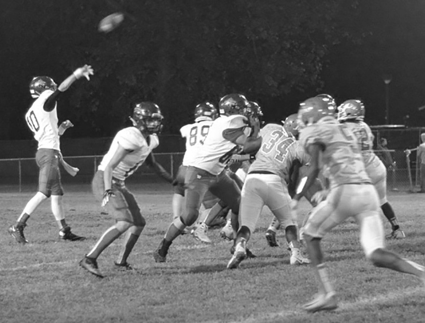 Preston Graham (10) launches a pass down field. -Laurie Knowles