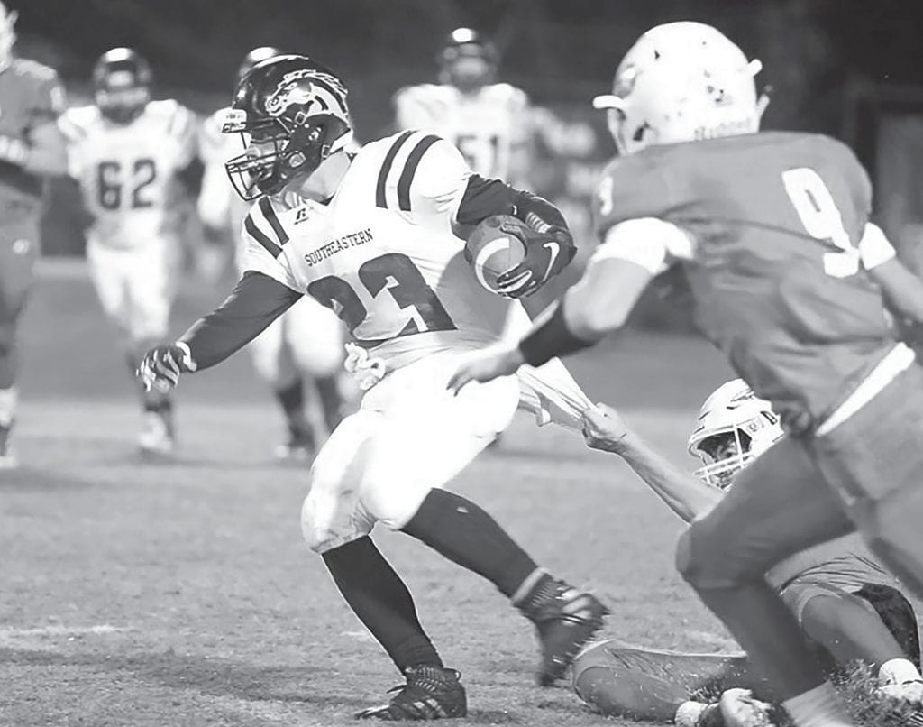 Noah McCray (23) evades an Ohatchee defender to gain yardage for the Mustangs. -Jeff Sargent