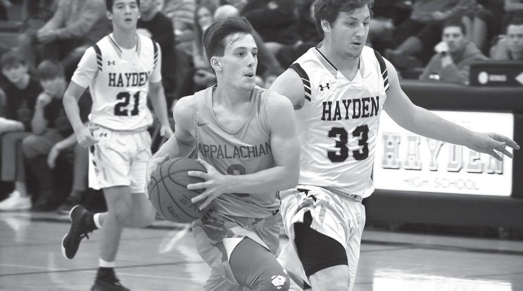 Appalachian's Noah Harris (3) looks to pass as Hayden's Korbin Register (33) and Collin Chappell (21) get into defensive positions. -Appalachian High School Media