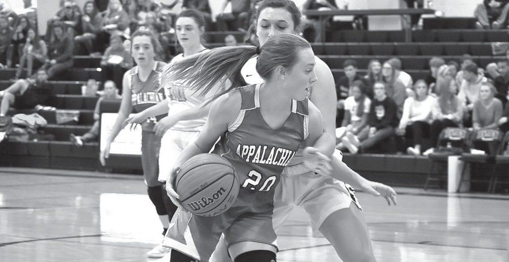 Gracey Gulledge (20) makes a move around a Hayden defender. -Appalachian High School Media