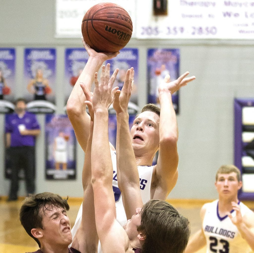 Tanner Sisson shoots over Southeastern defenders. -Sherry Abercrombie