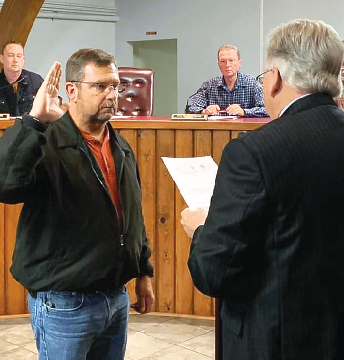 Newly appointed Oneonta City councilman Donald Bradley is sworn in by town attorney Alex Smith. -Dawn Bradley