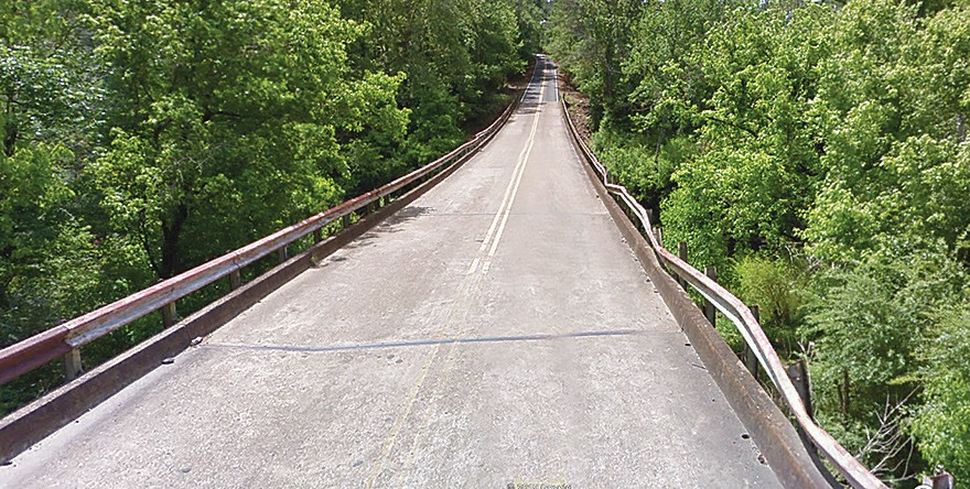 Guard rails on this bridge across Mulberry Fork on County Highway 51 (above) and two other county bridges will be replaced using funds from a $140,749 ALDOT grant. Such grants extend county district road budgets by allowing those funds to be used for other local road priorities. -photo courtesy Dustin Stewart