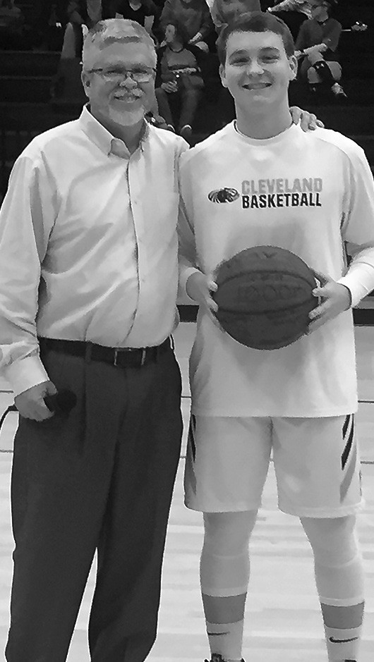 Logan Washburn (pictured with coach Connie Lowery) scored his 1,000th career point Dec. 27 during the Locust Fork Holiday Classic. Logan is a sophomore at Cleveland and is the son of Brian and Heather Washburn. -Heather Washburn