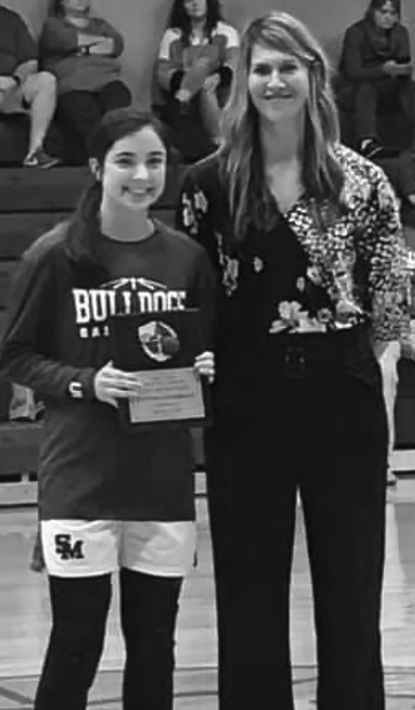 Hannah Lauderdale (pictured with coach Natasha Smallwood) scored her 1,000th career point Jan. 4 against Locust Fork. She was recognized during a ceremony on Jan. 10. Lauderdale is a junior at Susan Moore and is the daughter of Heath and Sarah Lauderdale. -photo courtesy of Natasha Smallwood