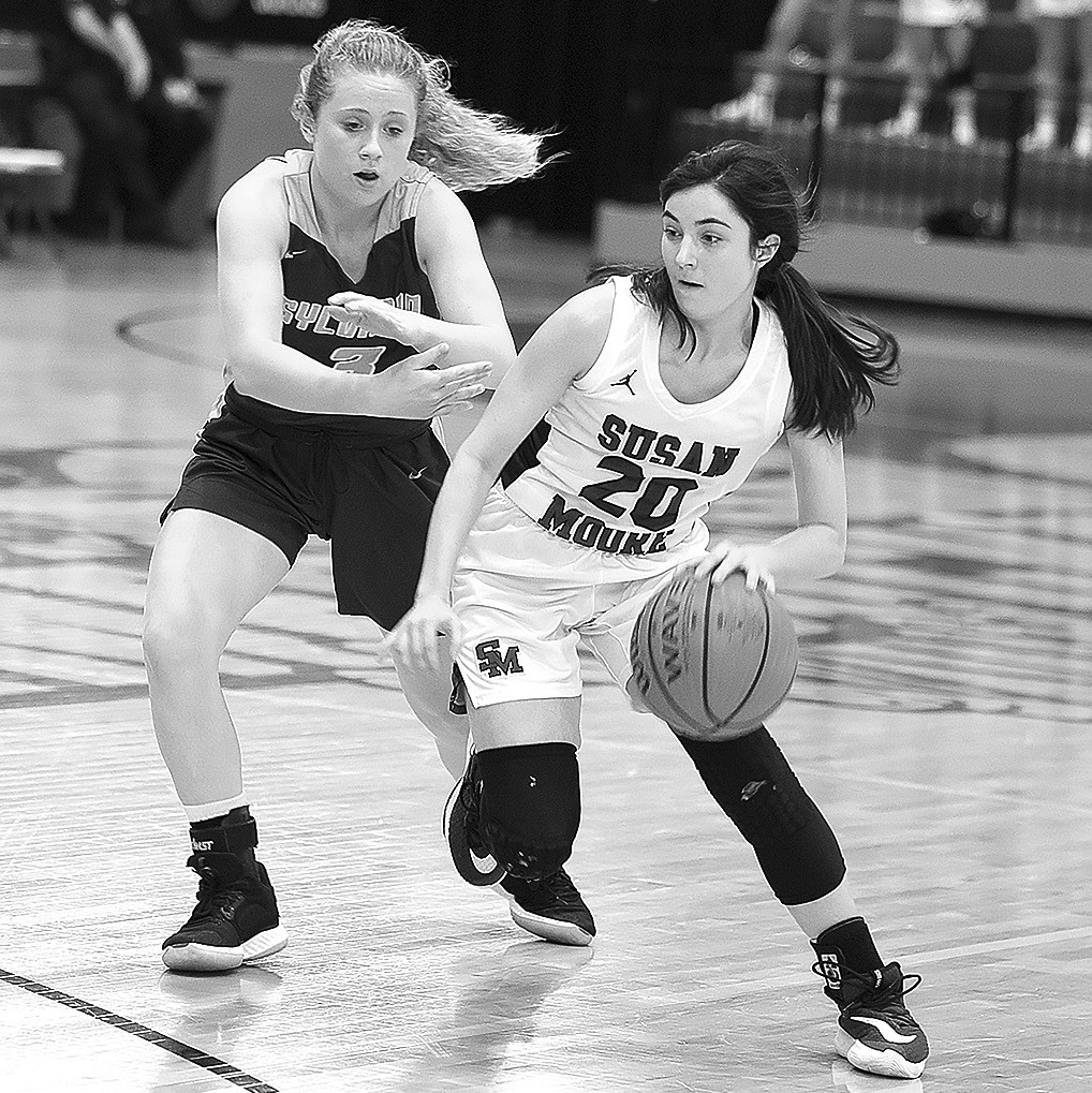 Susan Moore's Hannah Lauderdale pushes the ball down court against a Sylvania defender. -Sherry Abercrombie