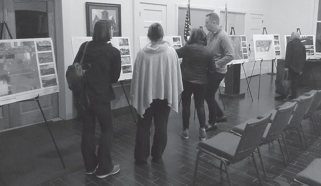Councilman Richard Phillips discusses proposed plans for local revitalization with attendees at last week's city council work session to gather input from citizens.