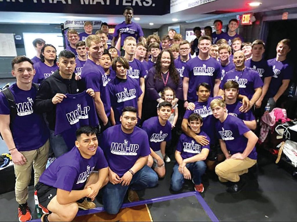 Susan Moore High School football players sport their Man Up t-shirts.