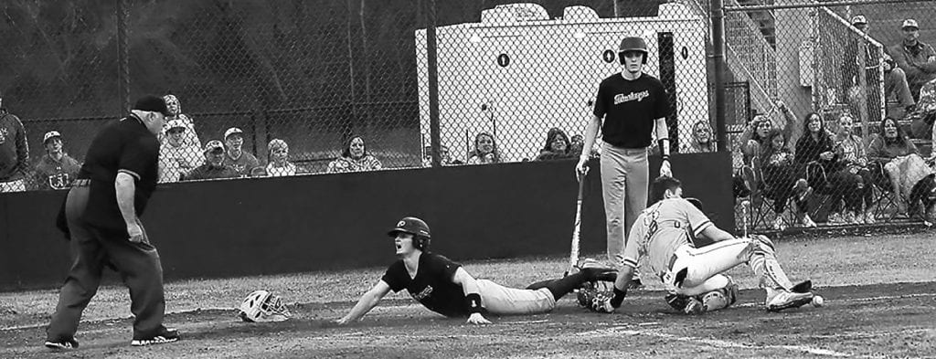 Southeastern's Christian Lemley looks to the umpire for a call on a close play at home plate during the county tournament championship. -Joel Sargent