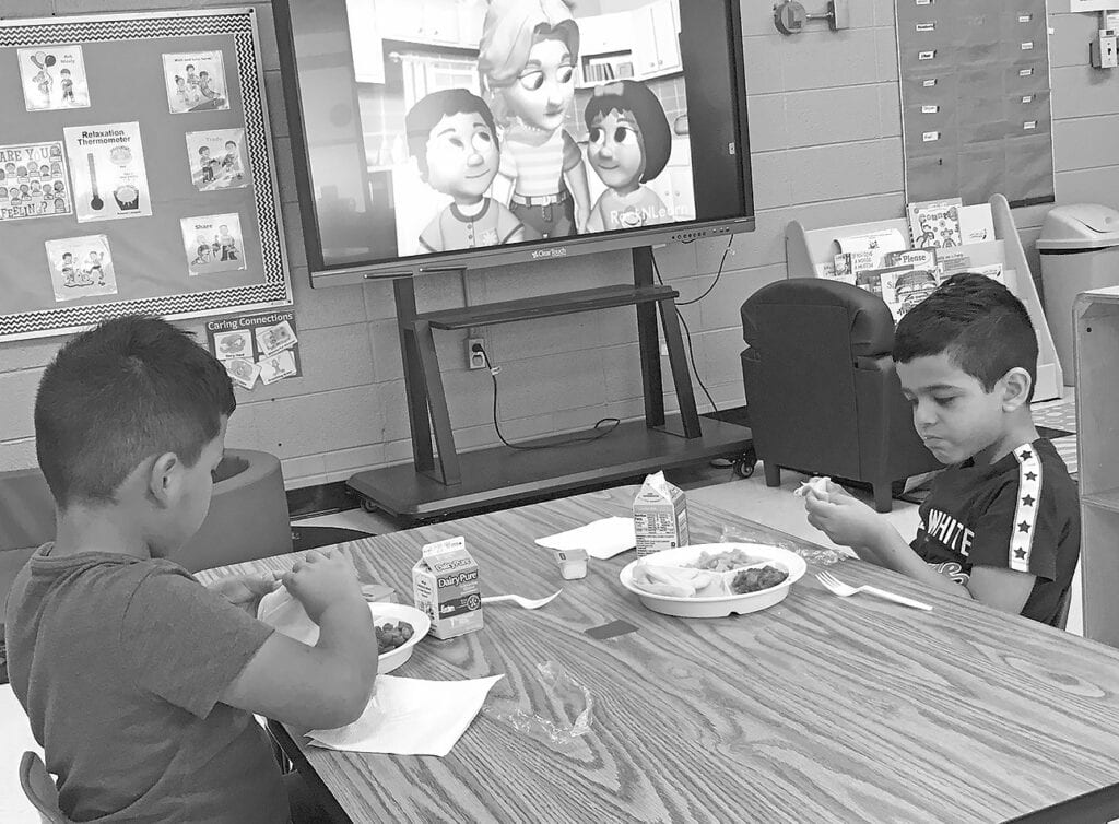 Gaspar and Giovanni enjoy lunch and TV time.