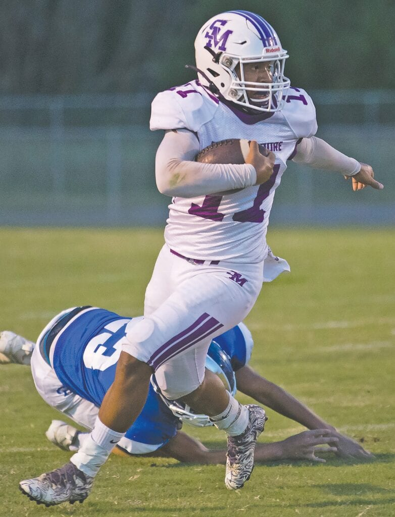Susan Moore running back Ramon Maldonado leaves a Carbon Hill defender in the dirt. -Sherry Abercrombie