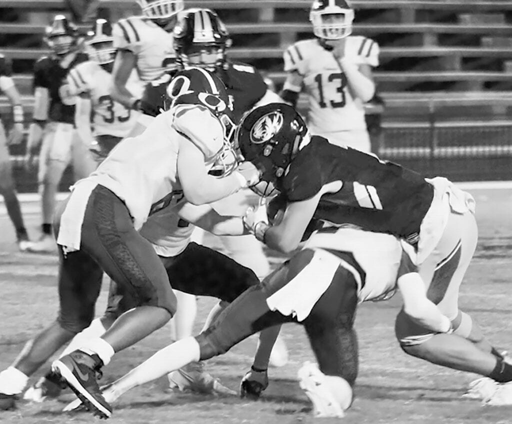 Sawyer Heptinstall is taken down by Oakman Wildcats. Heptinstall had 11 catches for 132 yards in the hard-fought overtime loss.