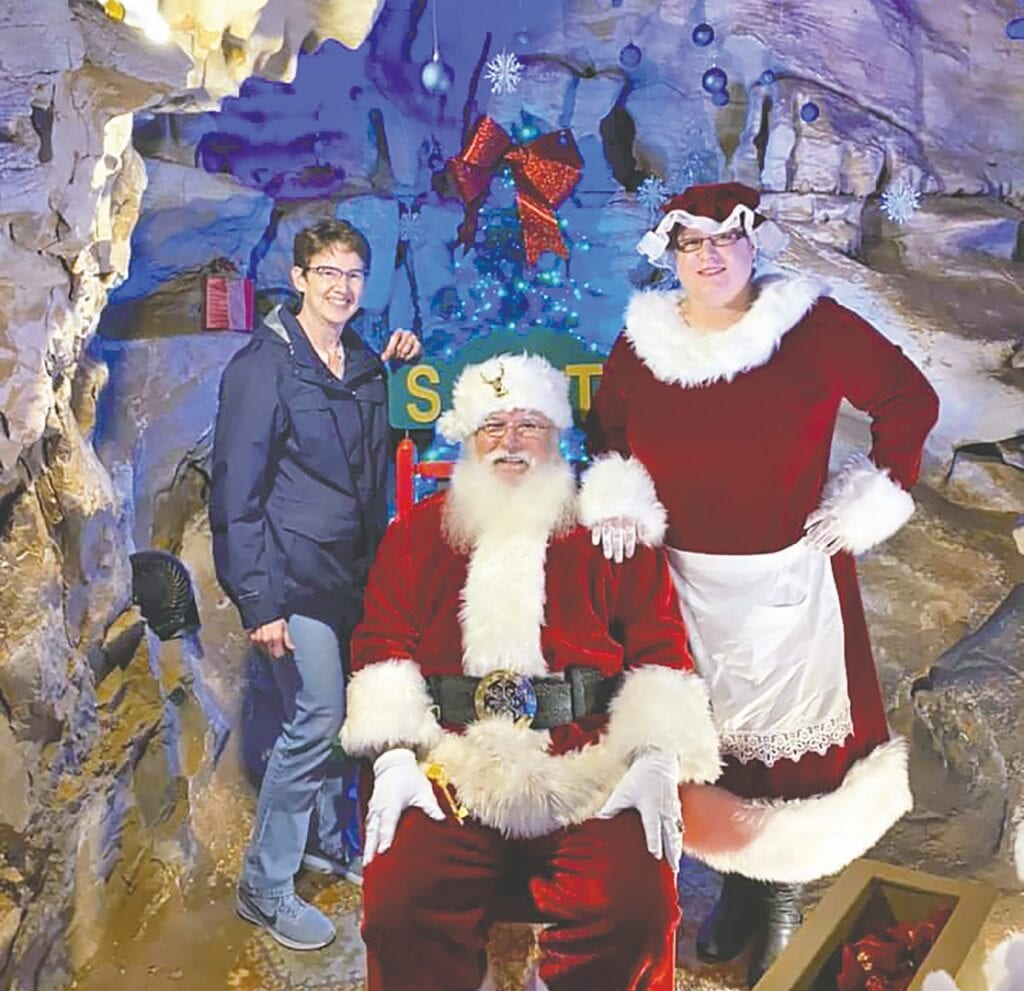 Chamber executive director Barbara Andersen visits with Santa and Mrs. Claus at Rickwood Caverns. -Blount County - Oneonta Chamber of Commerce