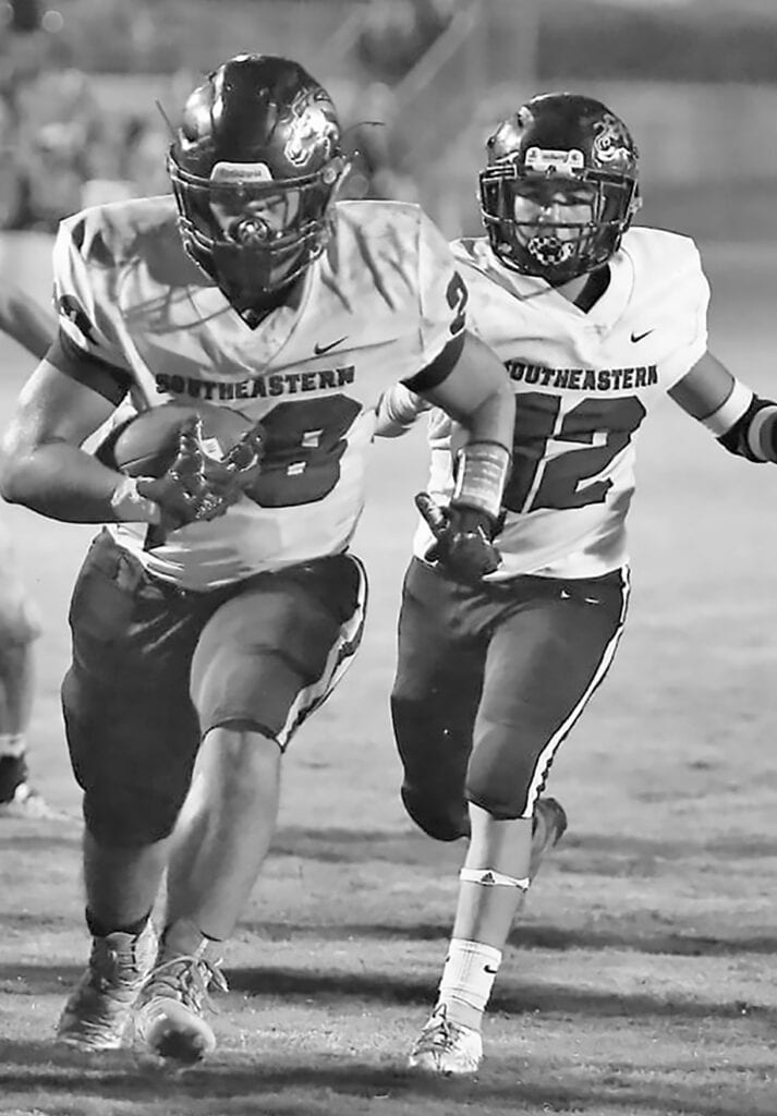 Kevin Juhola (28) and Fernando Chavez (12) add to Southeastern's 210 rushing yards against Oak Grove. -Jeff Sargent