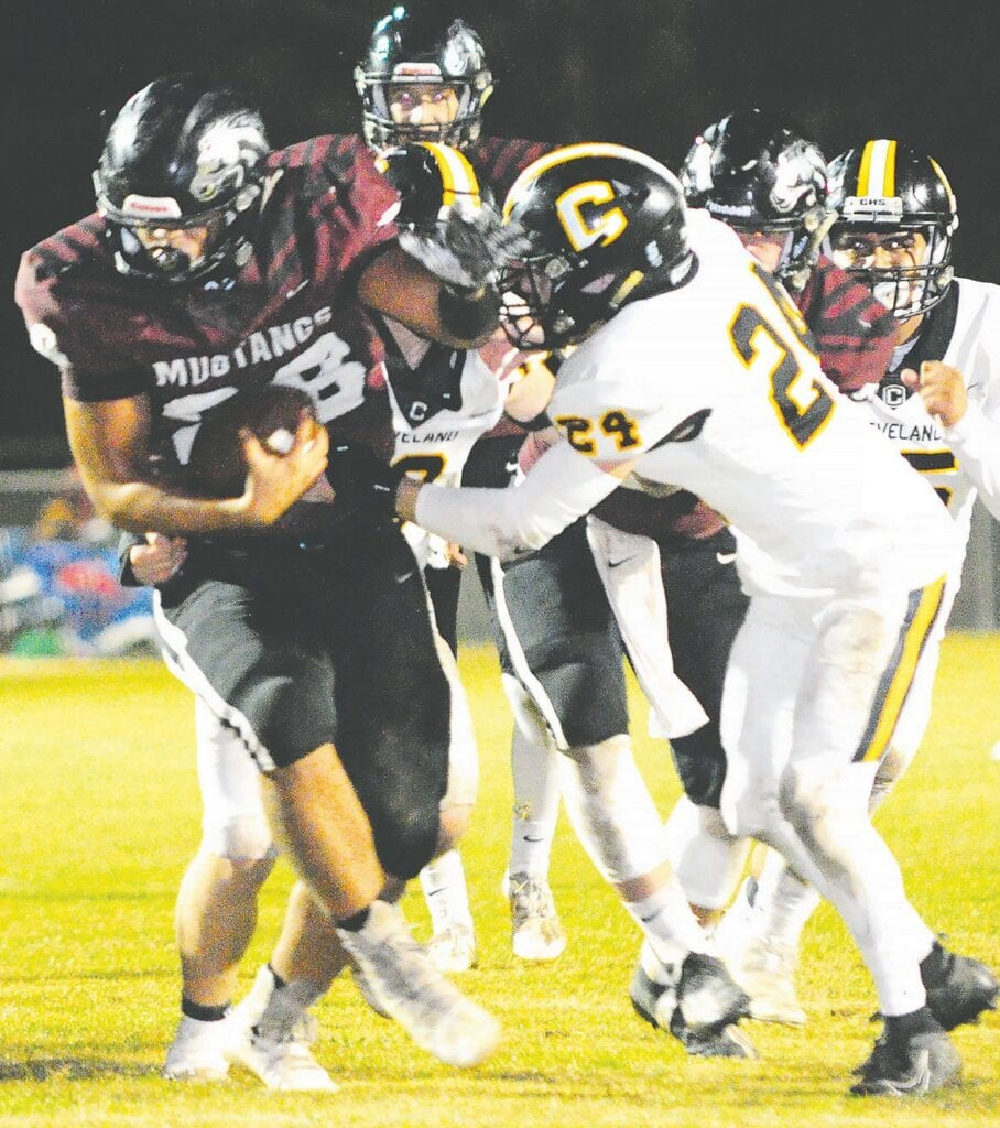 Southeastern's Kevin Juhola muscles through Cleveland's Gabriel Weems. -Keith Standridge