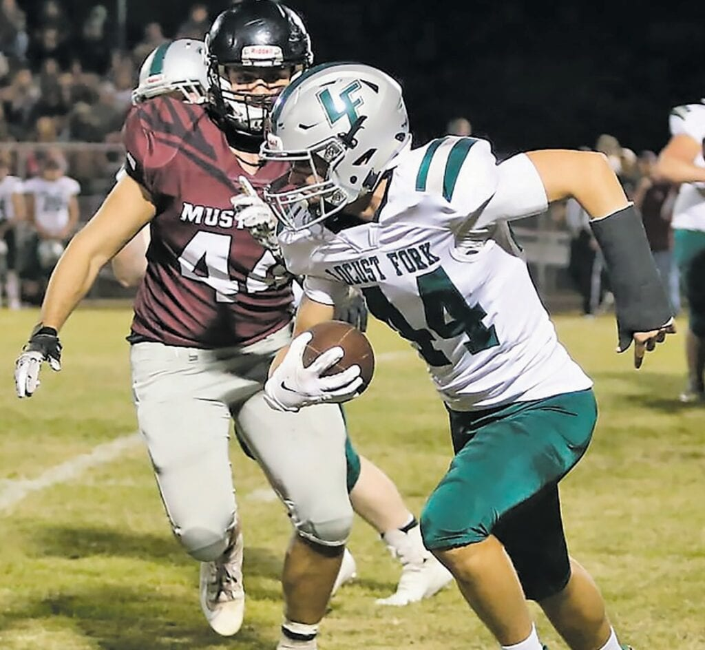 44 vs. 44: Southeastern's Ian Phillips pursues Locust Fork's Michael Mullins. -Jeff Sargent