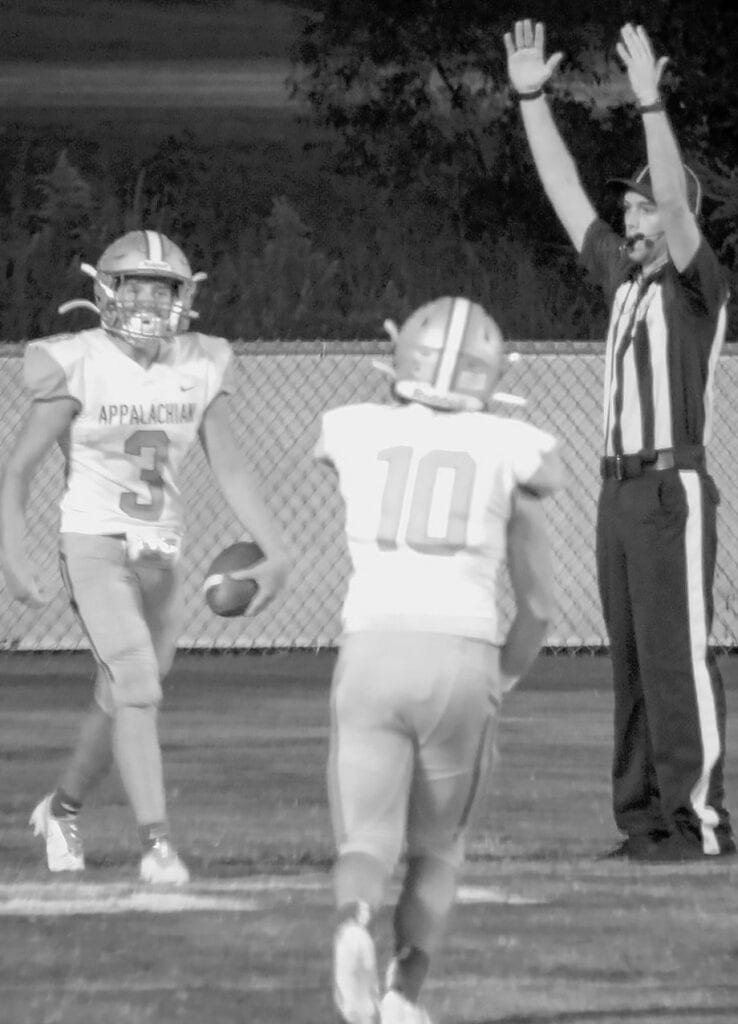 The referee signals as Bryson Seawright (3) scores Appalachian's first touchdown against Sumiton. Joey Williams (10) approaches to congratulate his teammate. -Kelli Clark