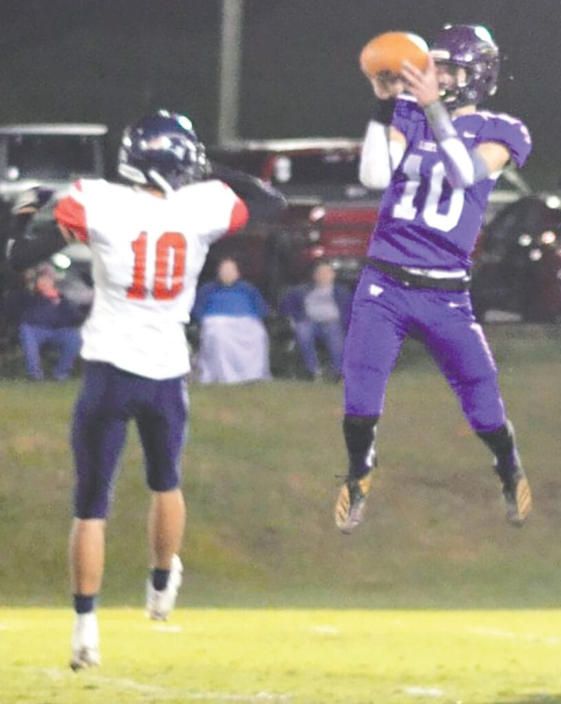 Preston Graham leaps over an East Central defender to make a catch. -Lauri Knowles