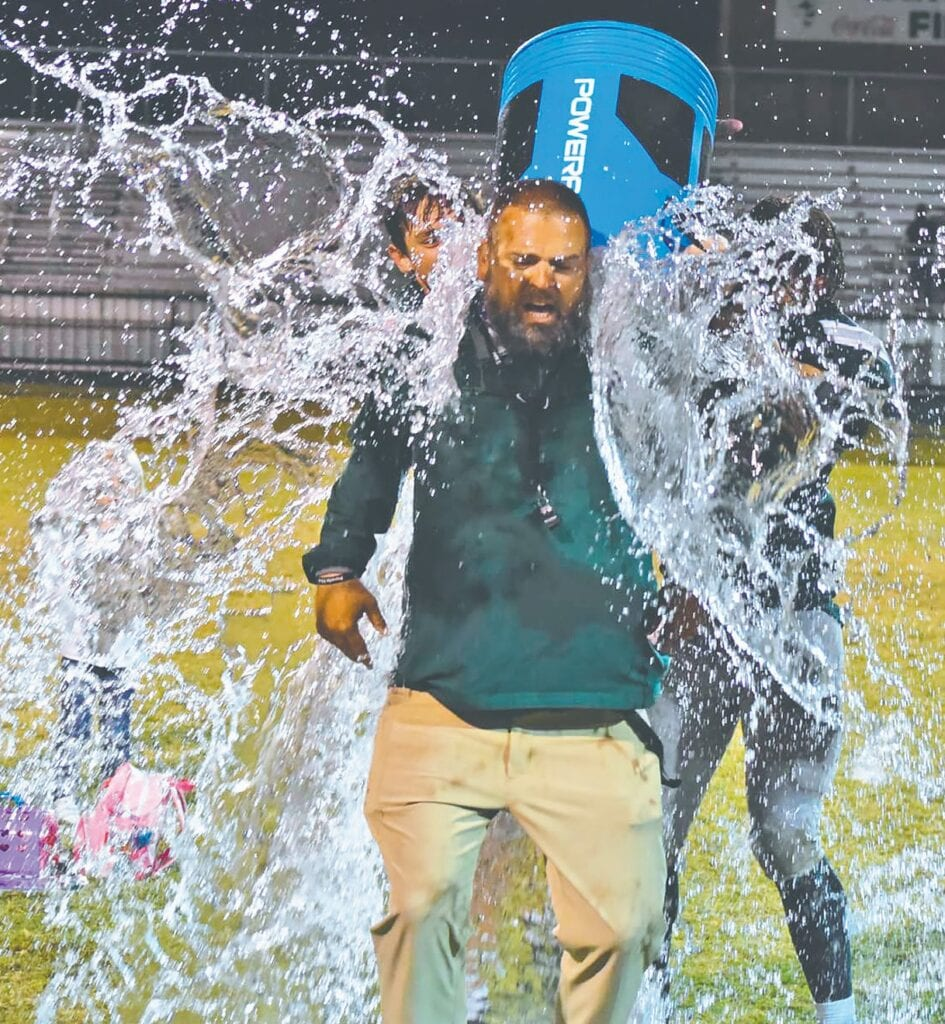 Head Coach Matt Plunkett gets doused in celebration of his 50th win. -Locust Fork Media