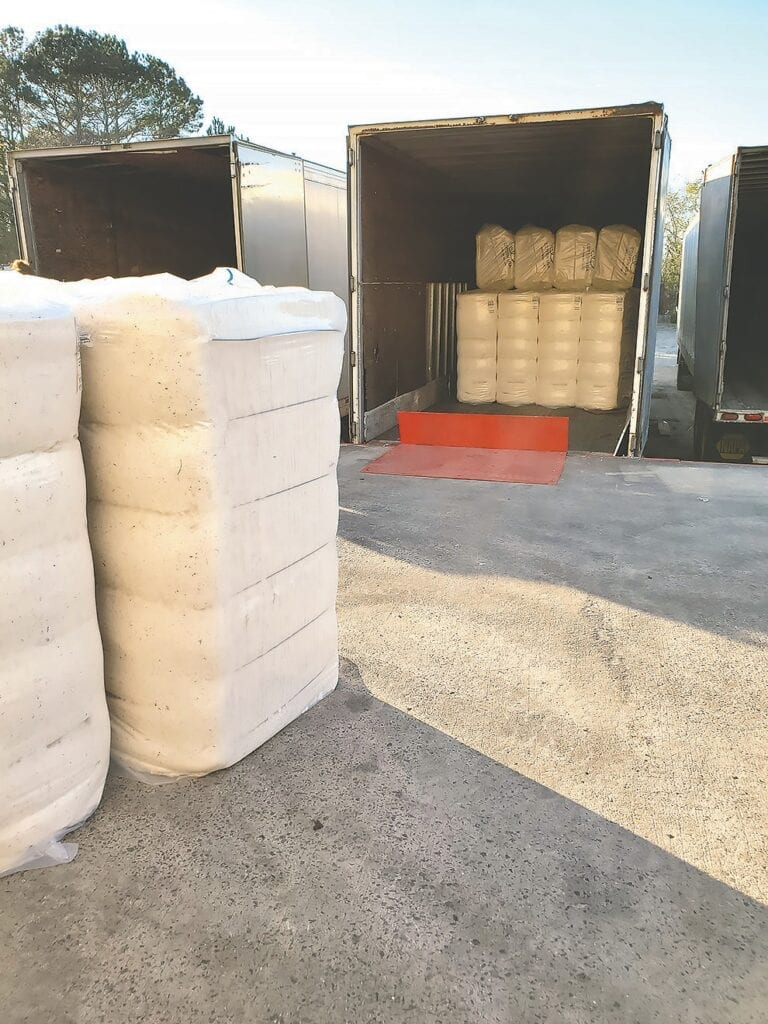 Clean cotton baled and loaded for delivery.