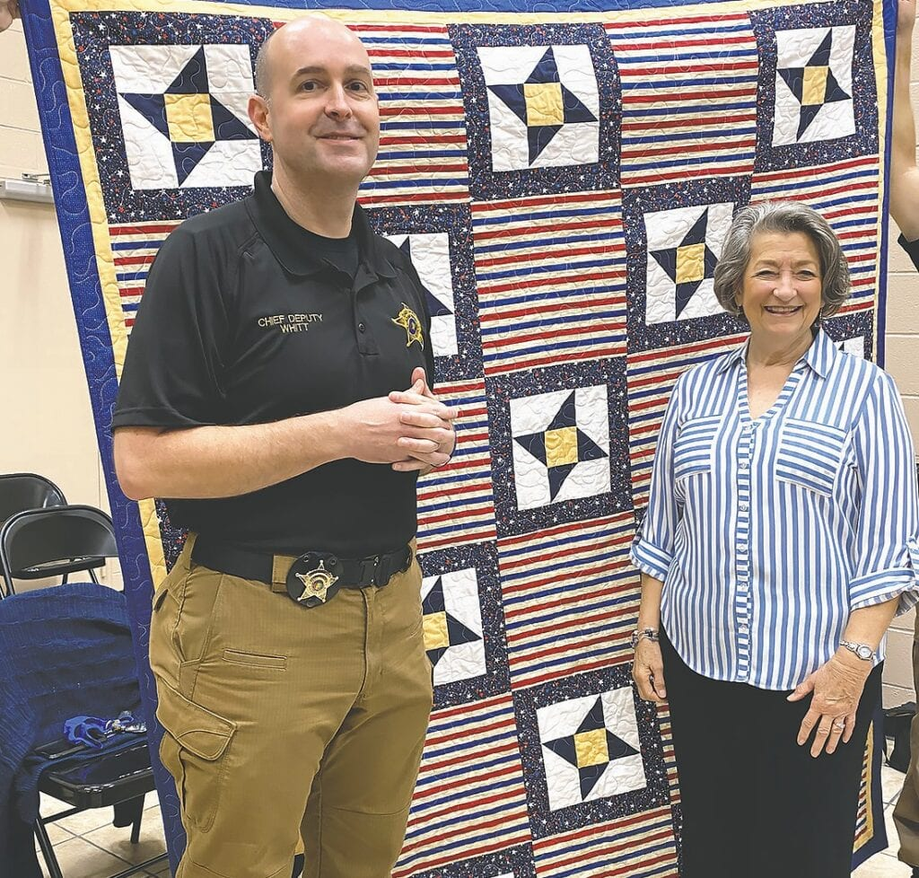 Blount County Sheriff's Department chief deputy Brian Whitt and quilter Suzanne Fornaro. -Blount County Quilters Guild