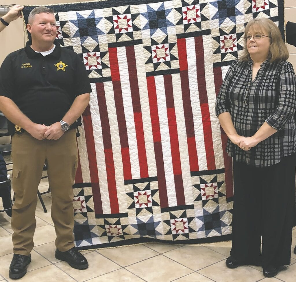 Blount County Sheriff's Department Capt. Ron Adkins and quilter Charlene Allison. -Blount County Quilters Guild