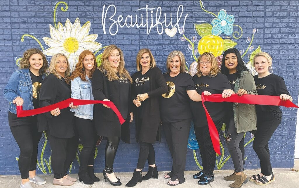 From left: Morgan Chambers (lash enhancement), Annette Kent (receptionist), Kylie Dunn (hair stylist), Toni Smith (co-manager and skin care specialist), Deanna Whited (owner and skin care specialist), Jamie Summers (boutique manager), Becky Bosner (hair stylist), Kennya Garcia (hair stylist), and Kristin Moore (massage therapist). -Blount-Oneonta Chamber of Commerce