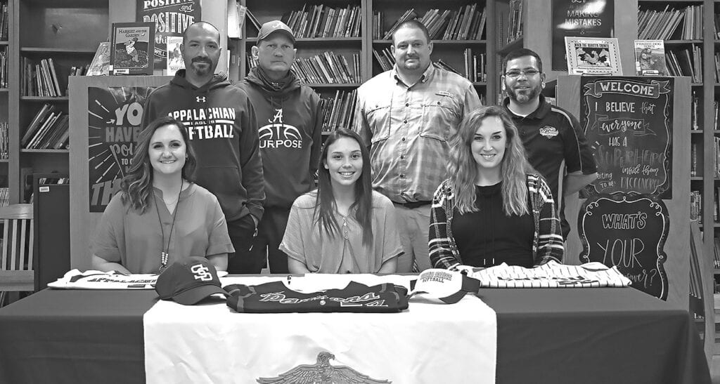 Zoe Payne signs with Snead State Community College. Seated, from left: coach Ashley Belding, Payne, and coach Morgan Morton. Standing, from left: coaches Danny Davis, Dusty Dean, Neal Whittington, and Carlos Rivera. -Crystal Sharp