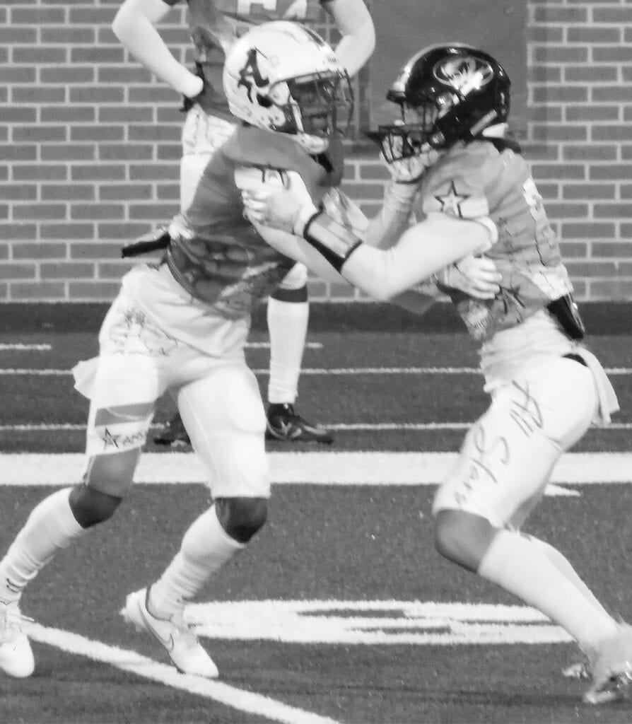 Sawyer Heptinstall (right) plays in the 62nd North-South All-Star Classic at the University of South Alabama. -AHSAA