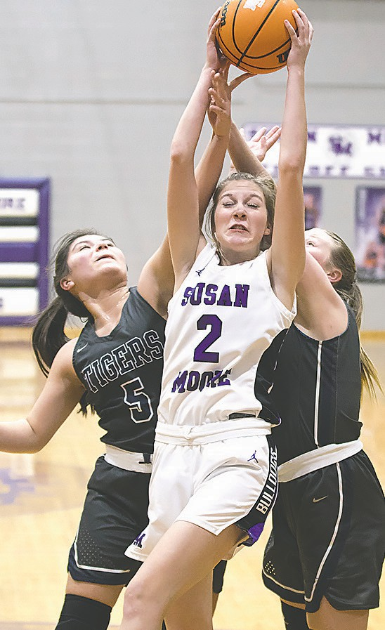 Susan Moore's Lacey Floyd (2) battles with Pennington defenders for the ball. -Sherry Abercrombie