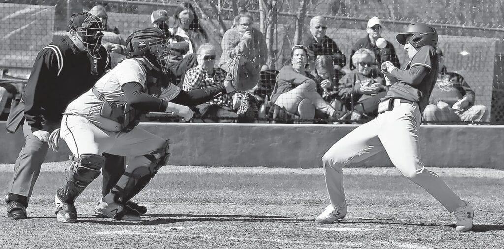 Southeastern's Trent Carpenter dodges a wild pitch. -Jeff Sargent