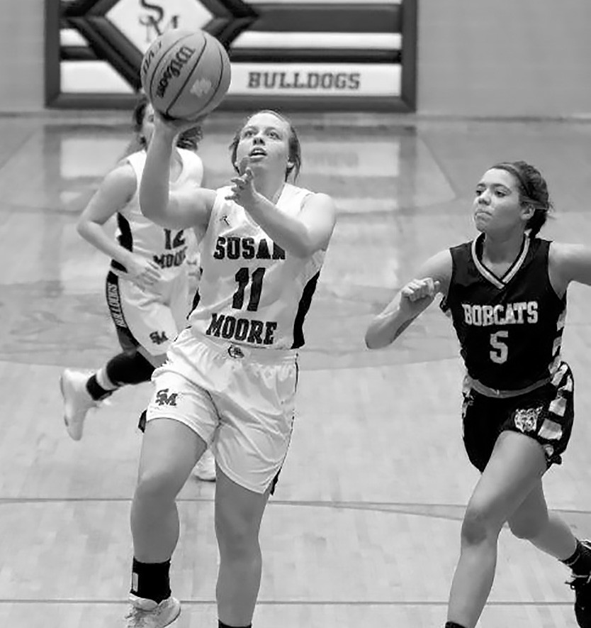 Susan Moore's Kaitlyn Hill (11) takes an easy layup against Phil Campbell. -Sherry Abercrombie