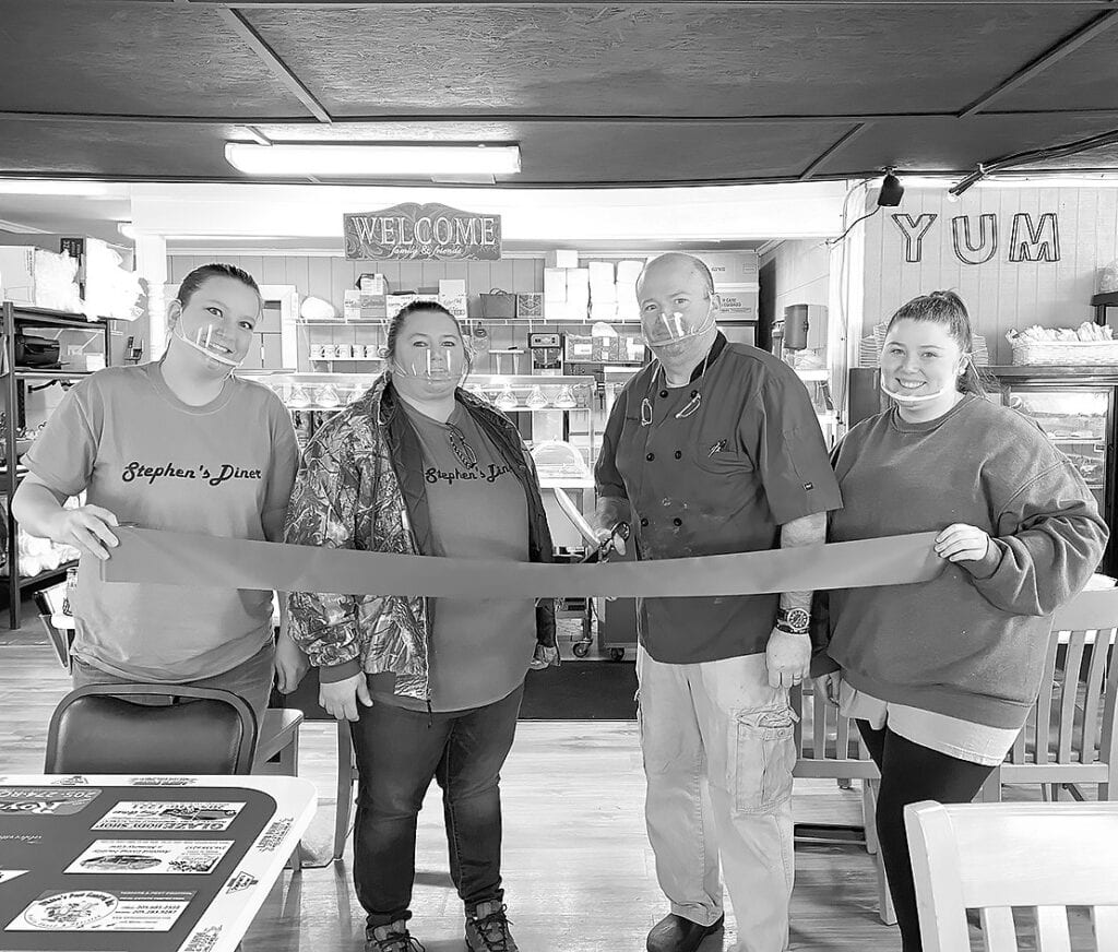 From left, Amanda Evans, Misty Dobbs, Stephen Hill, and Ella Hill at the grand reopening of Stephen's Diner. -Barbara Andersen