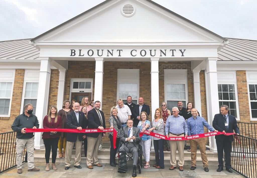 Blount County Probate Judge and County Commission Chairman Chris Green cuts the ribbon to officially open the Hayden Courthouse Annex.