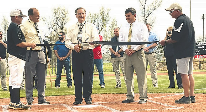 Rodney Green (center), Blount County Schools superintendent, cuts the ribbon officially opening Cleveland High Schools new baseball and softball fields. Joining him are (from left) Cleveland baseball coach Micheal Johnson, principal Brannon Smith, assistant superintendent Chris Lakey, and Cleveland softball coach Larry Thigpen.