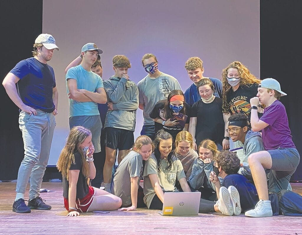 The cast of 'Aladdin Jr.' review a scene to improve blocking. -OHS Music and Drama