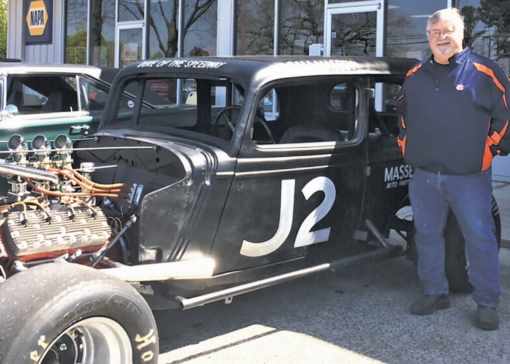 Mike Massey displays his father's 1934 race car at S&S Automotive's classic car show in March.