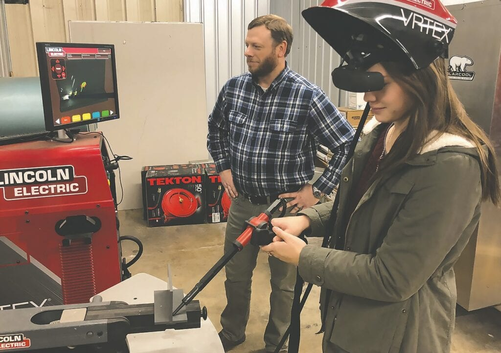 Welding instructor Chris Posey and student Allison Morton. -photo courtesy Wallace State