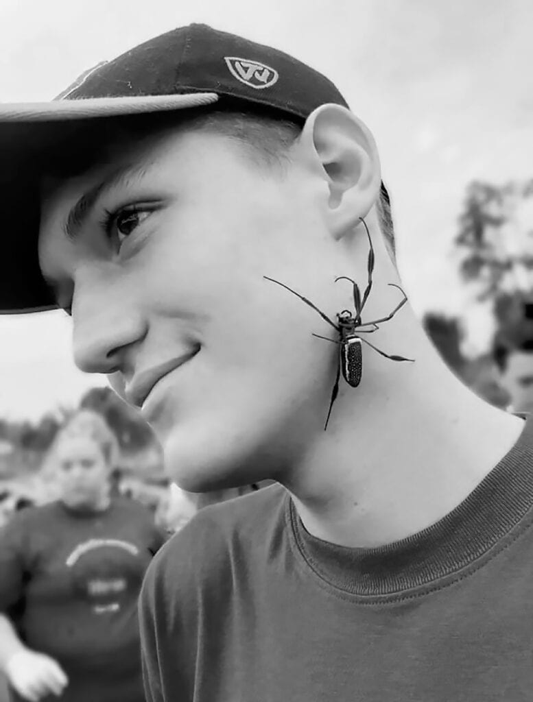 Drew Marbut calmly displays one of Ecuador's critters. -courtesy Drew Marbut